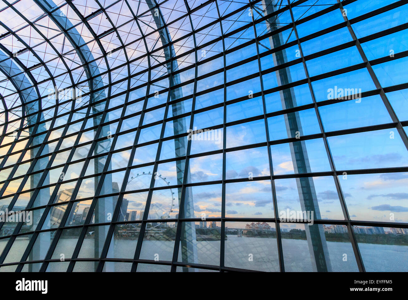 View of Singapore skyline by day from the Mediterranean climate Flower Dome garden of Gardens by the Bay - Stock Image