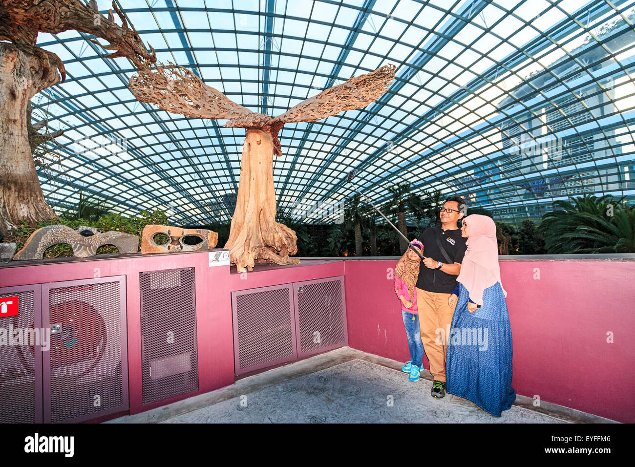 Muslim family takes 'selfie' photo at the Mediterranian climate Flower Dome garden in Gardens by the Bay - Stock Image