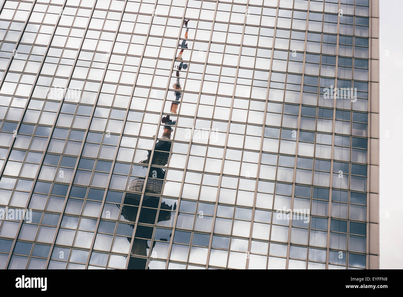 The Berlin TV tower is reflected in the windows of the Radisson Blu hotel as seen from Alexanderplatz. - Stock Image