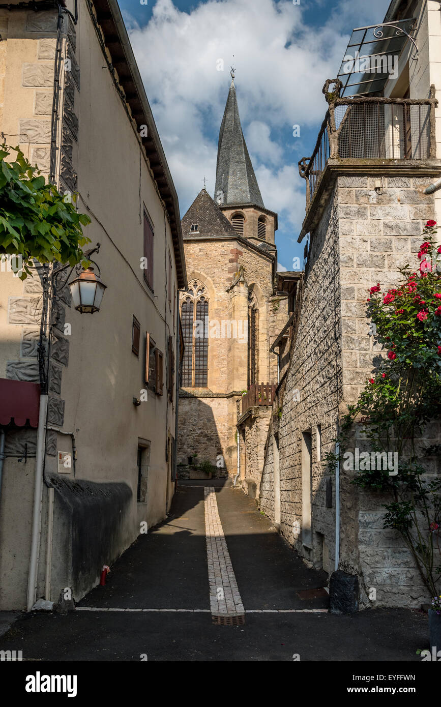 Church with spiral spire in the small town of St-Come-d'Olt, France - Stock Image