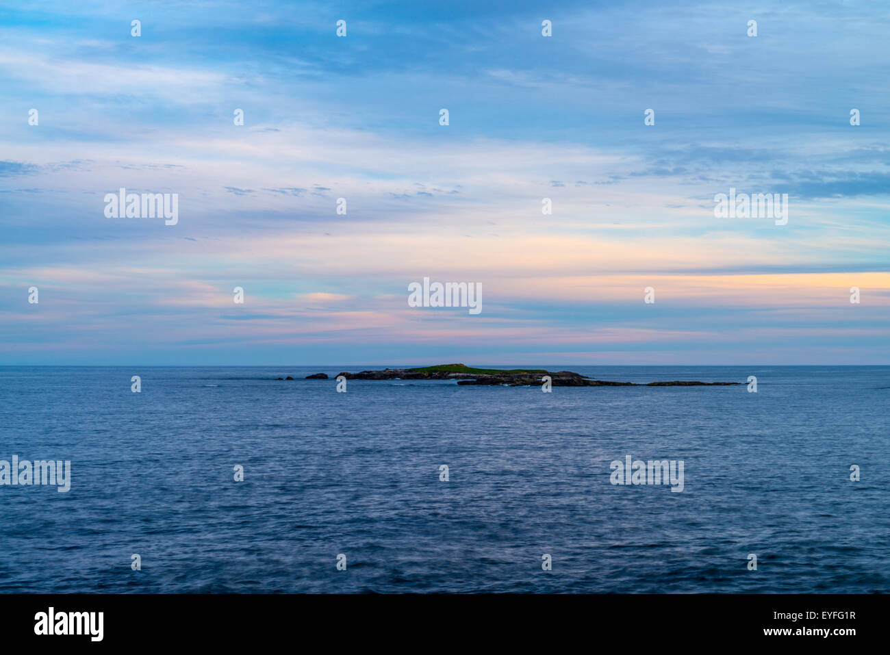 A small island in Atlantic Ocean viewed at sunset from Louisbourg lighthouse, Louisbourg, Nova Scotia, Canada - Stock Image
