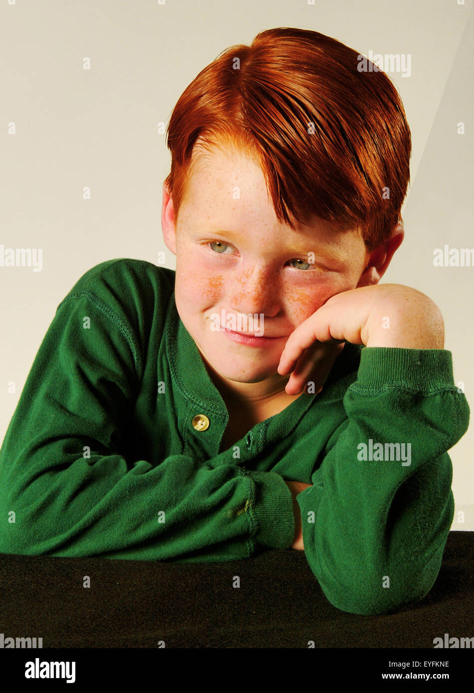 A self confident red-headed five year old boy poses in a studio in Laguna Niguel, CA. - Stock Image