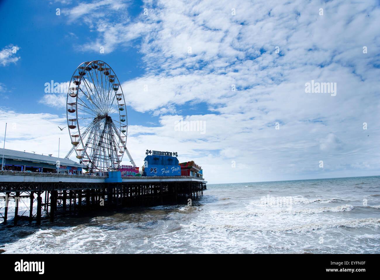 Blackpool central pier reaches out into the sea, Blackpool Pleasure beach; Blackpool, Lancashire, England - Stock Image