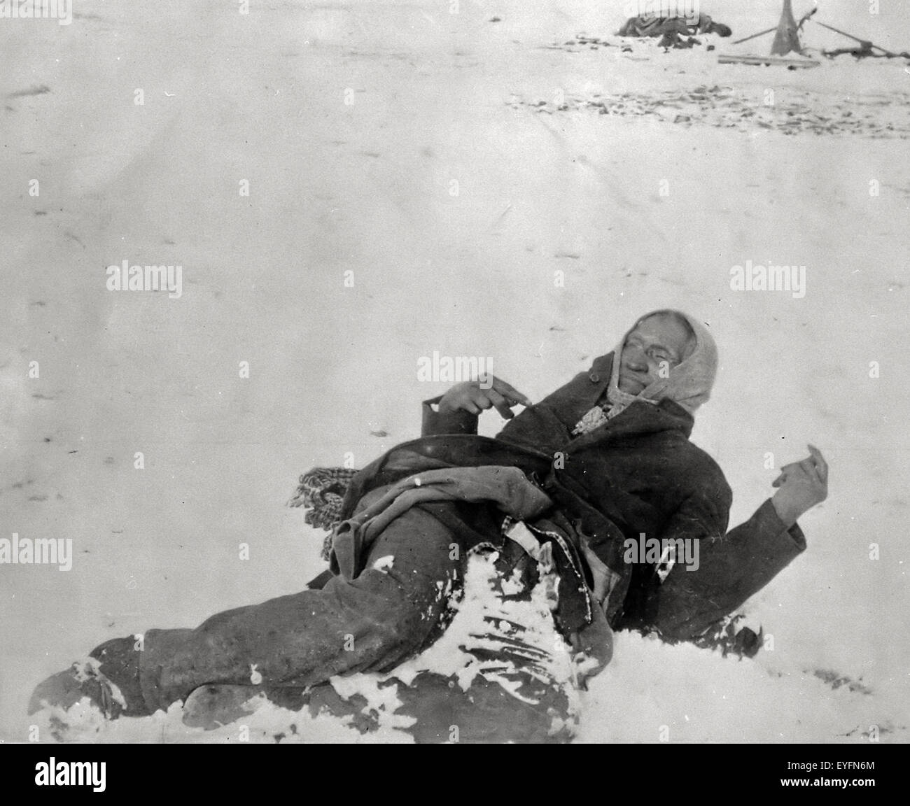 Miniconjou chief Spotted Elk (aka. Bigfoot) lies dead in the snow after massacre at Wounded Knee. December, 1890 Stock Photo