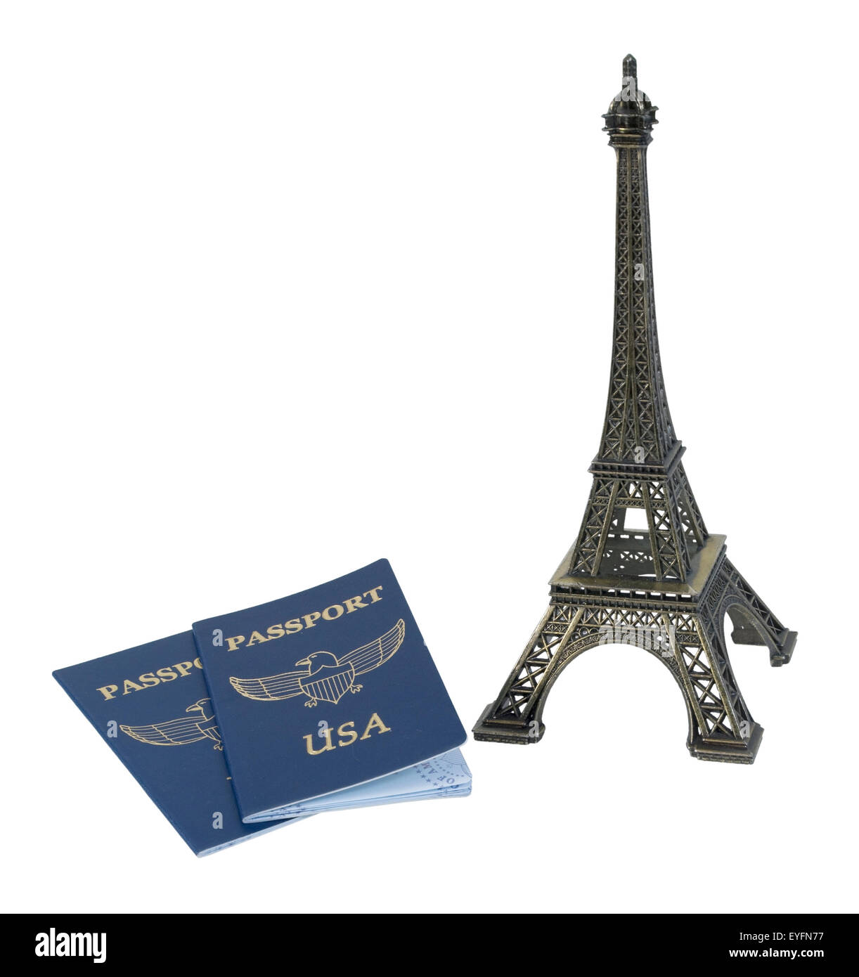 Metal Eiffel Tower model and a traveling passport - path included Stock Photo