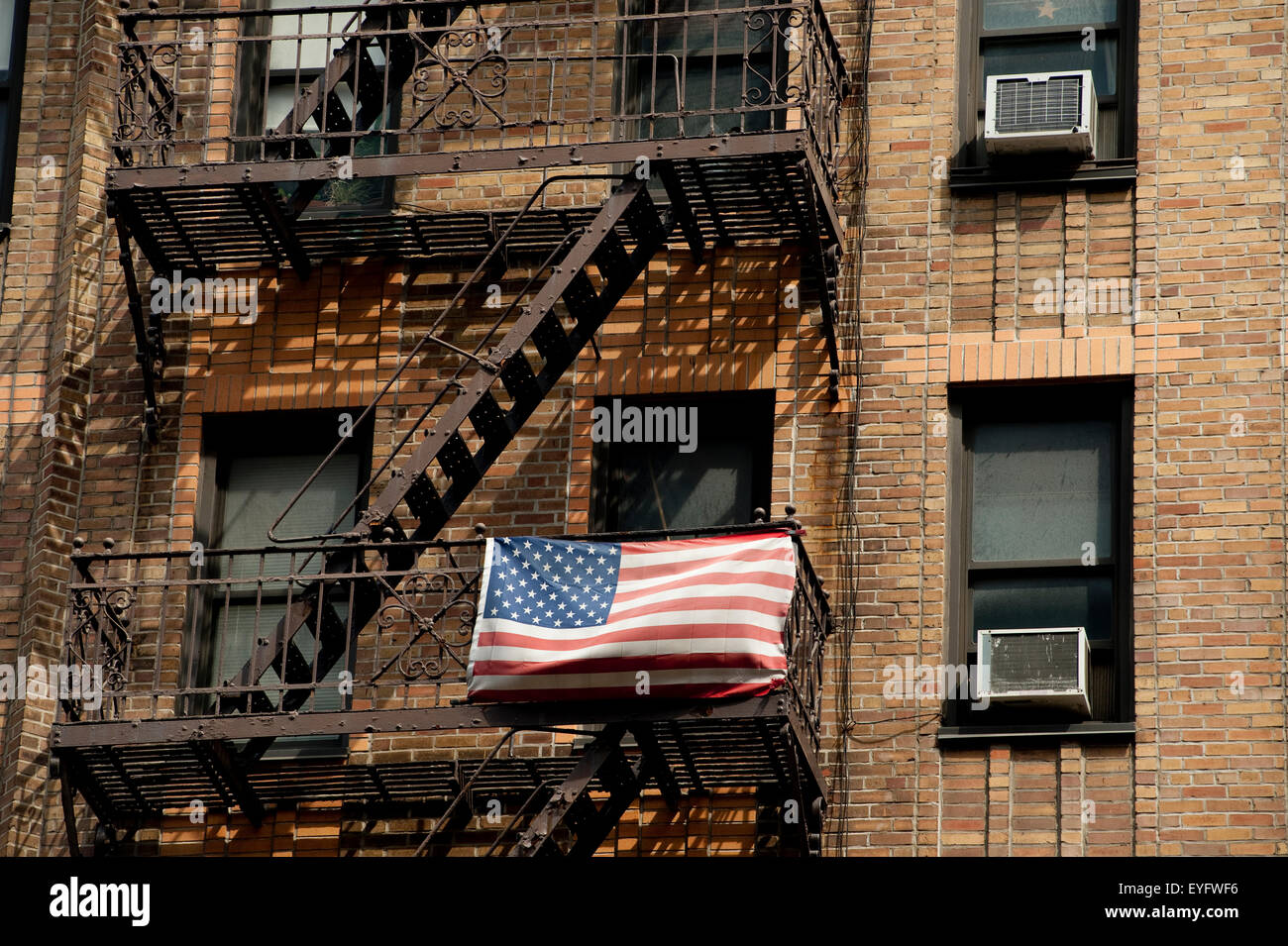 American Flag Outside An Apartments Building In Chelsea, Manhattan, New York,  Usa