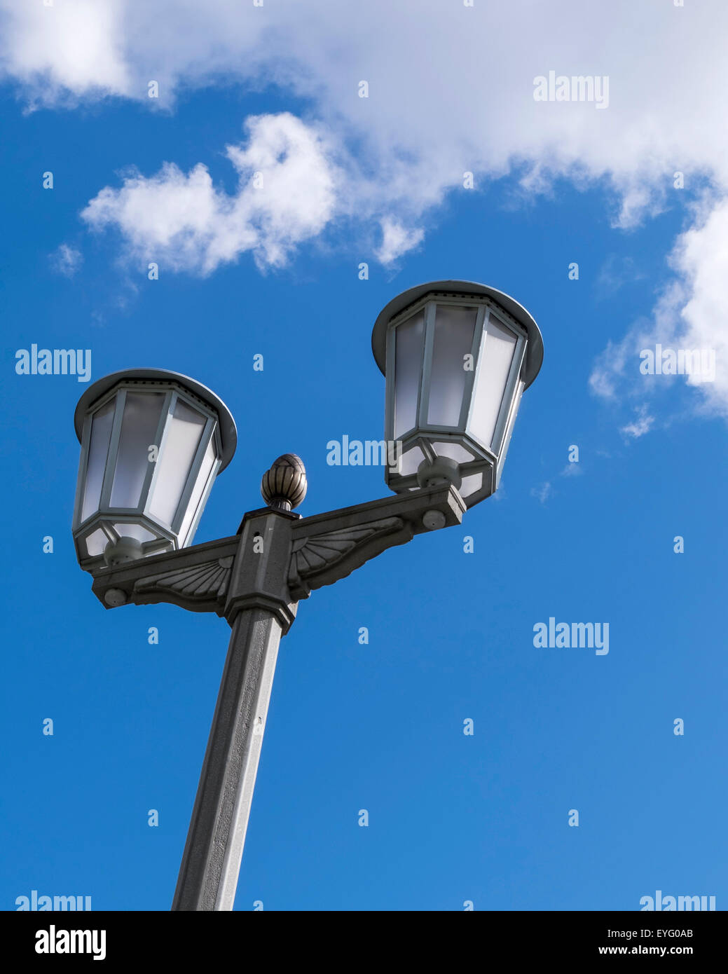 Attractive old street lamp against a blue sky,  Karl-Marx-Allee, Mitte, Berlin - Stock Image
