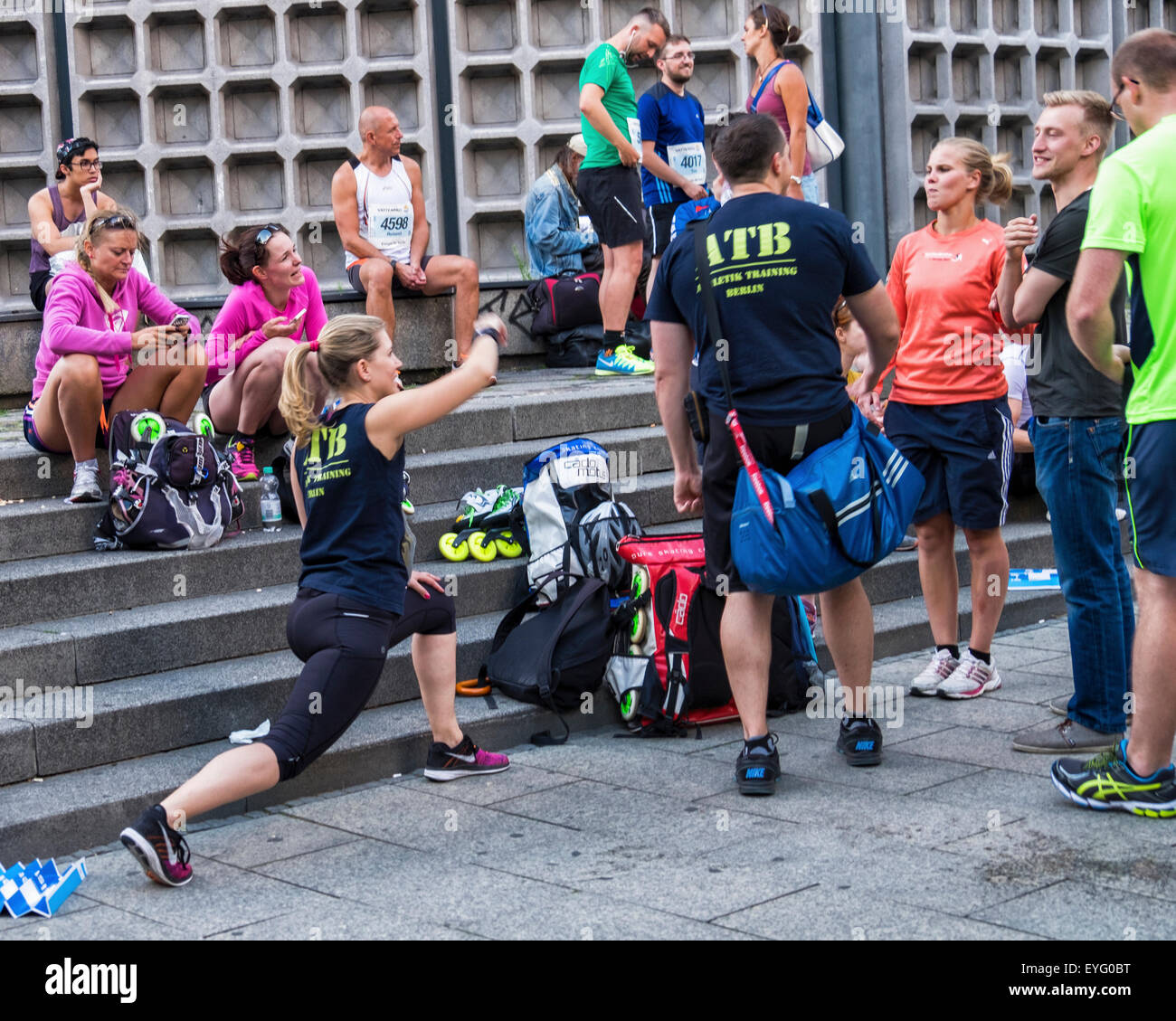 Berlin Kurfürstendamm, Athletes and runners wait for start of annual urban night fun run, the Berliner City - Stock Image