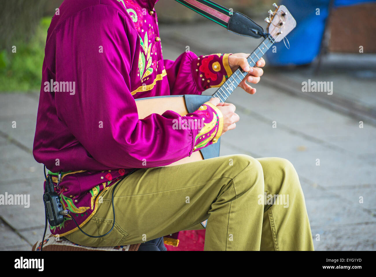 Man playing balalaika on the street. Unrecognizable person. - Stock Image