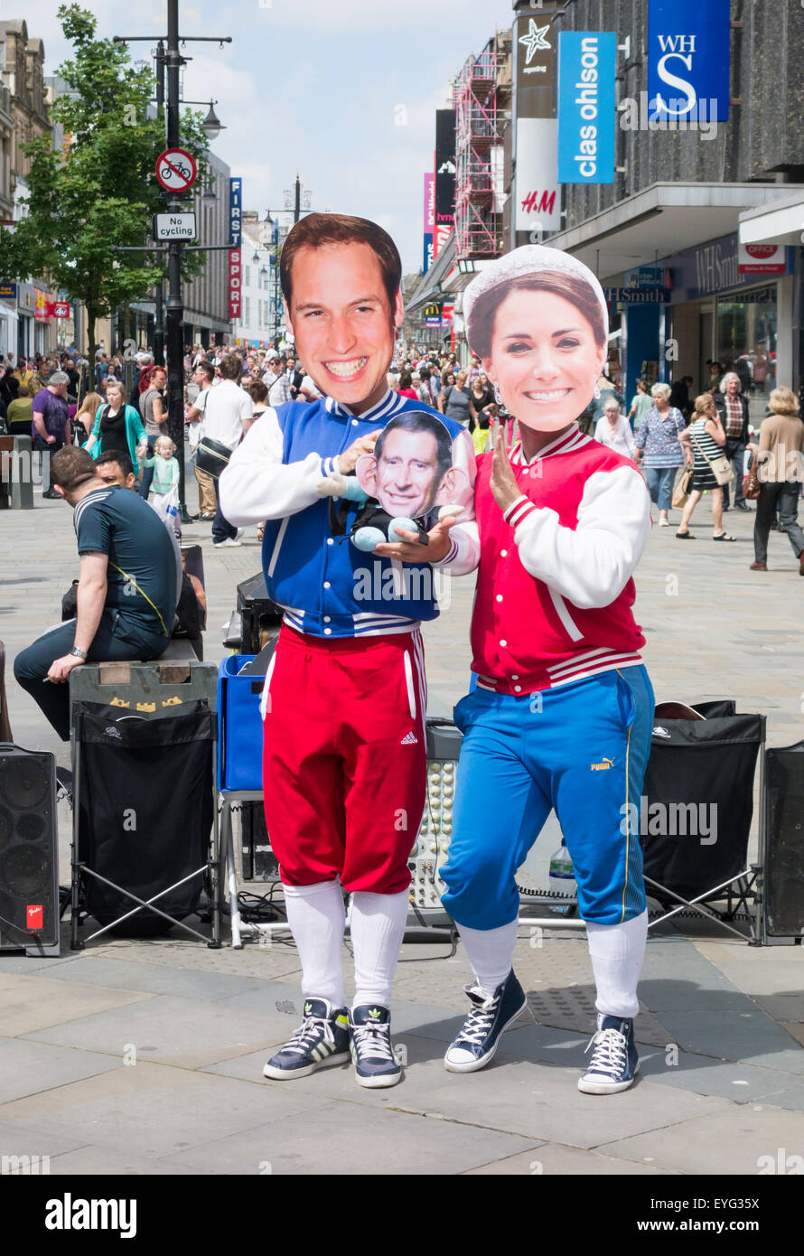 Buskers wearing masks of famous people/celebrites performing on Northumberland St. in Newcastle upon Tyne. England. Stock Photo
