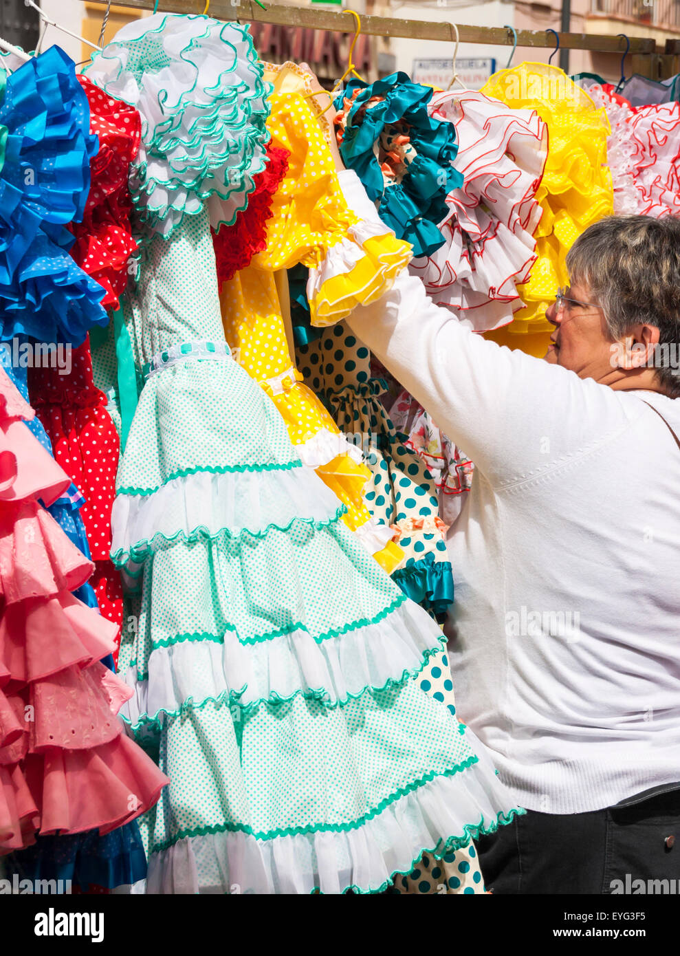 0755ee8fdc01a Secondhand Flamenco dresses on famous street Flea market in Calle Feria in  Seville, Spain -