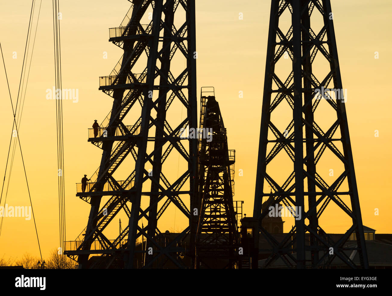 Workmen on stairwell of Tees Transporter bridge, Middlesbrough, England, UK - Stock Image