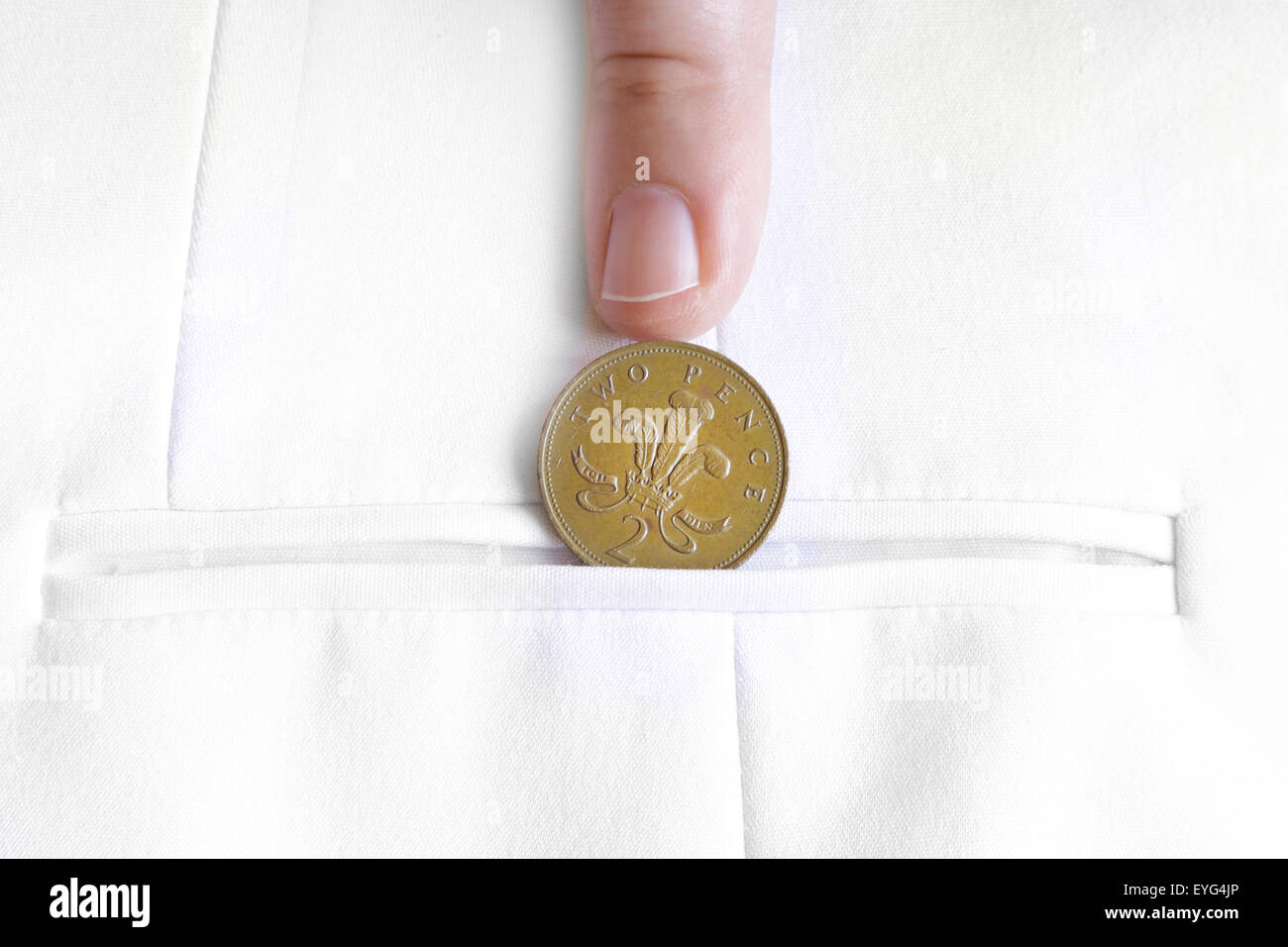 saved penny is penny earned proverb representing coin in jacket pocket - Stock Image