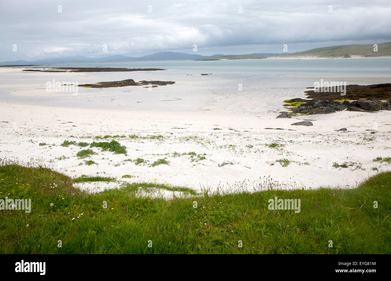 Overcast sky sandy beach Eoligarry, Barra, Outer Hebrides, Scotland, UK - Stock Image