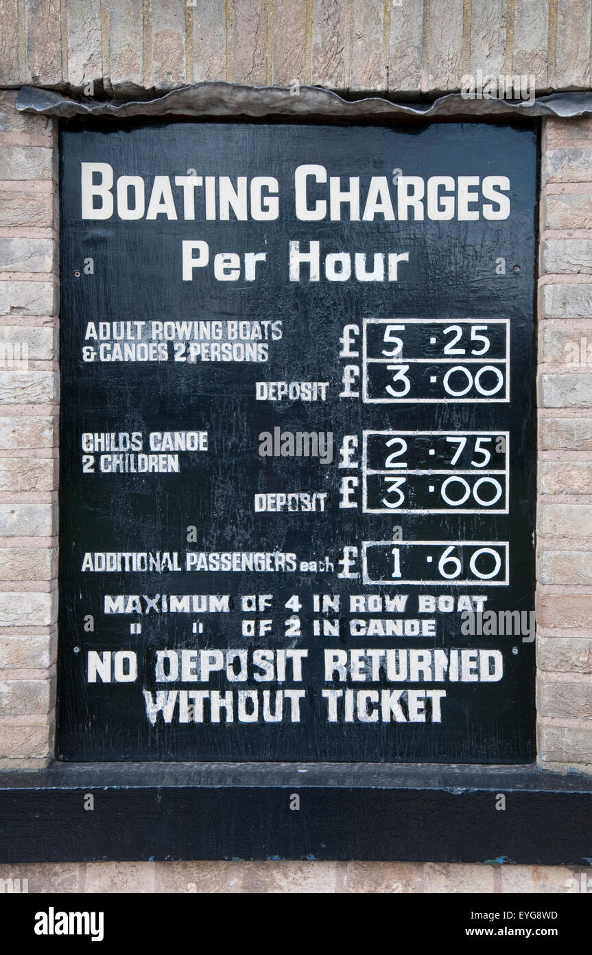 Sign displaying charges for the boating lake at Highfields Park, Nottingham England UK - Stock Image