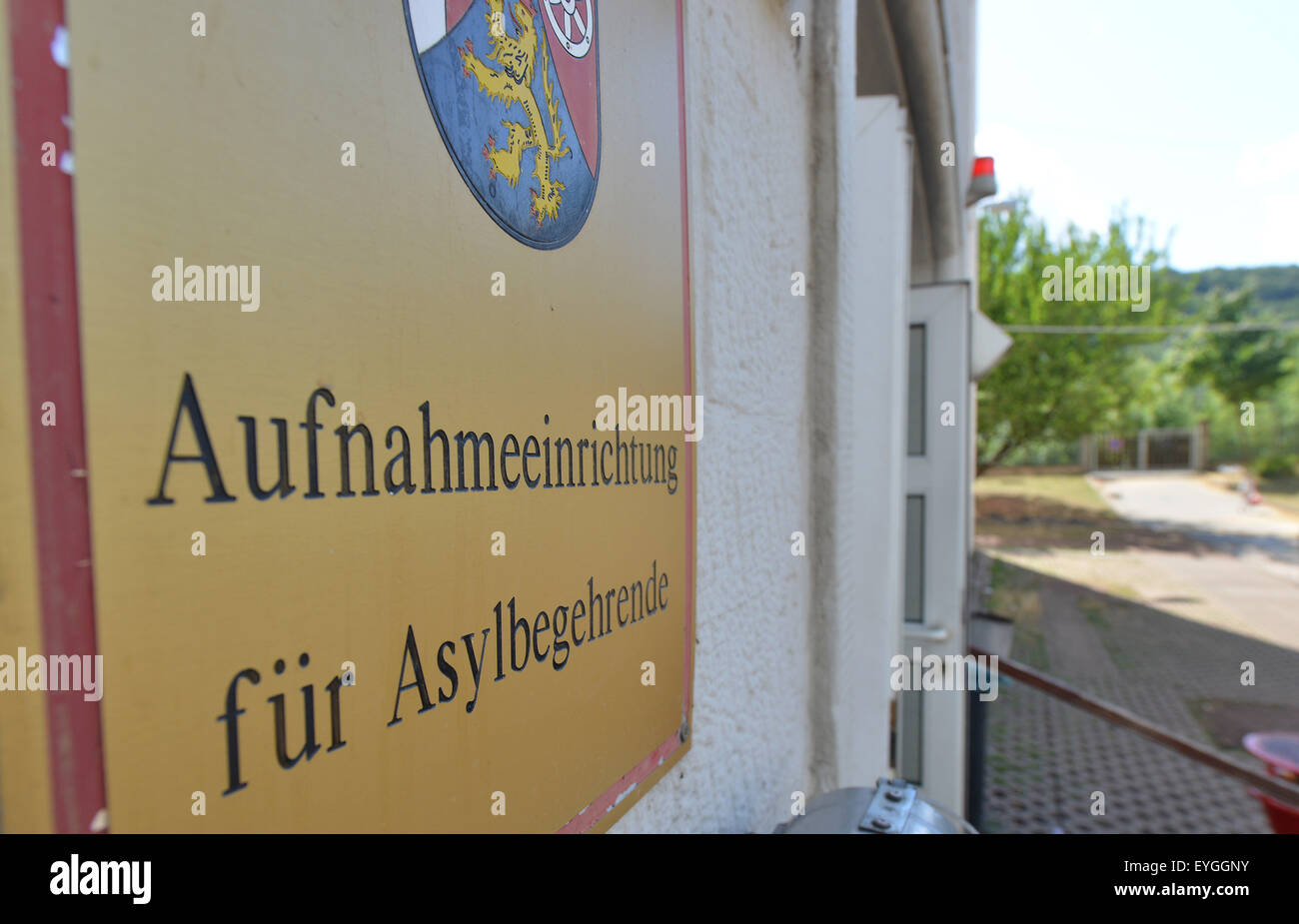 Trier, Germany. 29th July, 2015. View of a sign reading 'Aufnahmeeinrichtung fuer Asylbegehrende' (lit. reception Stock Photo