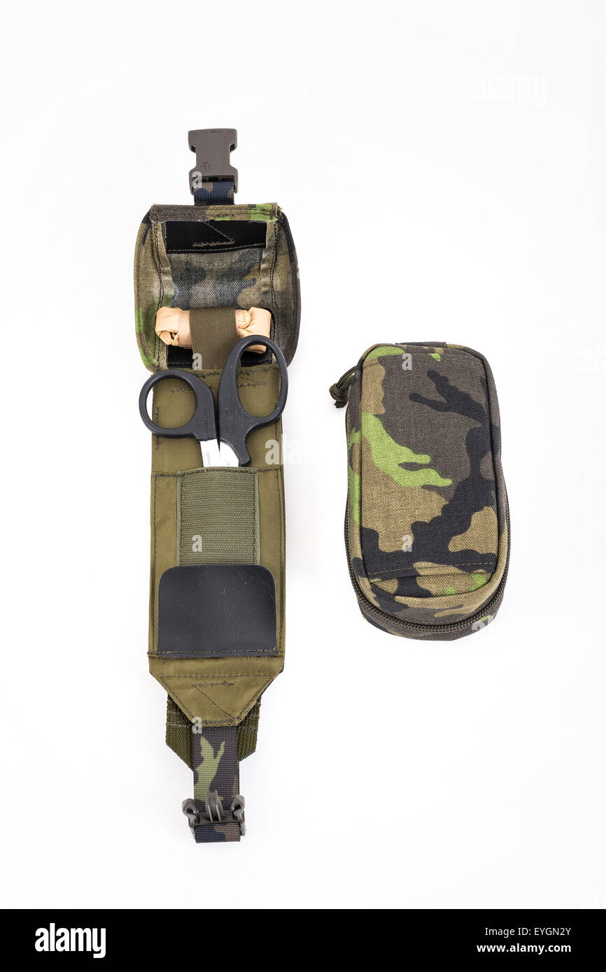 Travel first aid kit in camouflage housing for tourists and