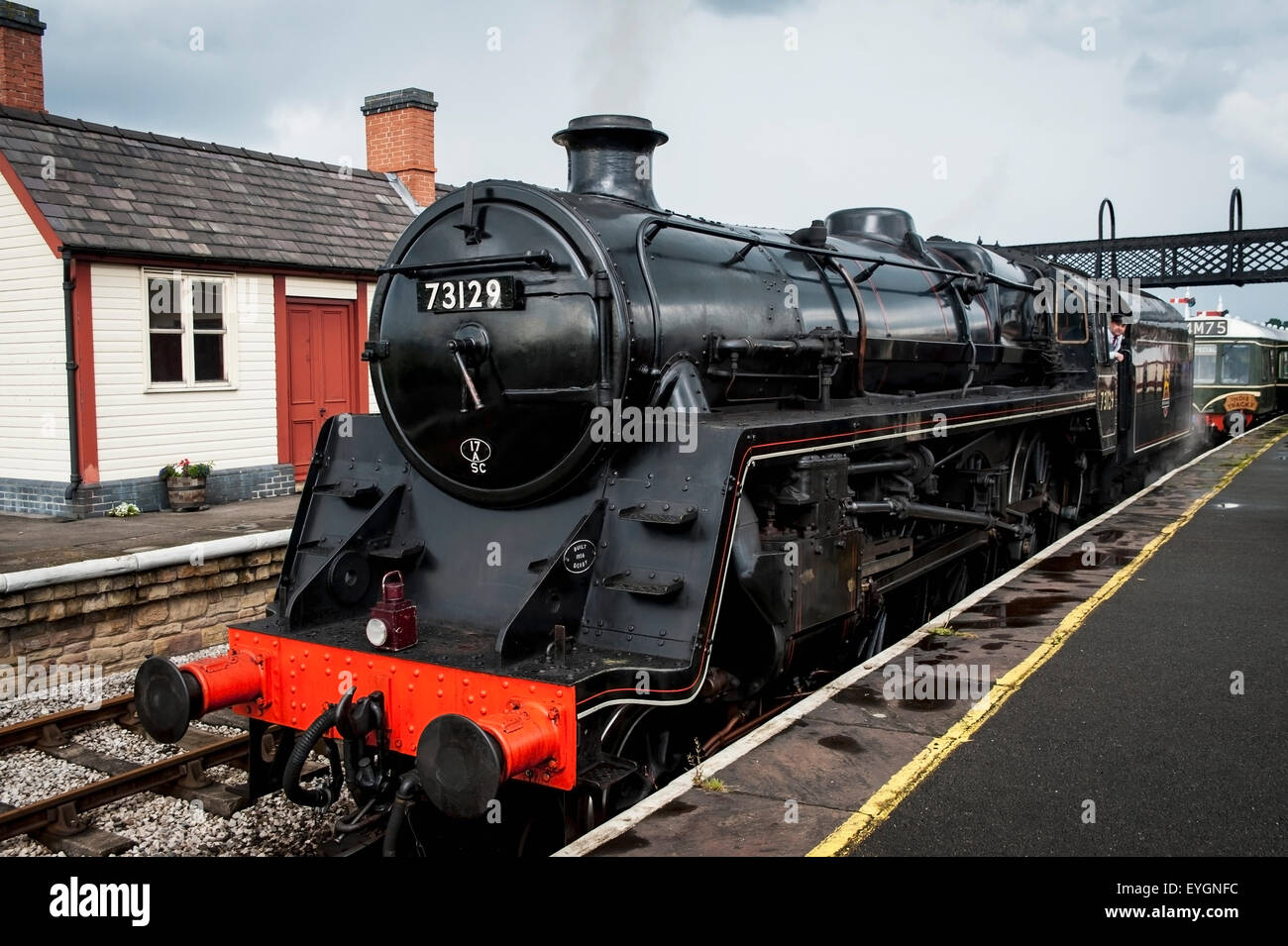 UK, England, Midland Railway; Derbyshire, Steam train arriving at Swanwick Junction - Stock Image
