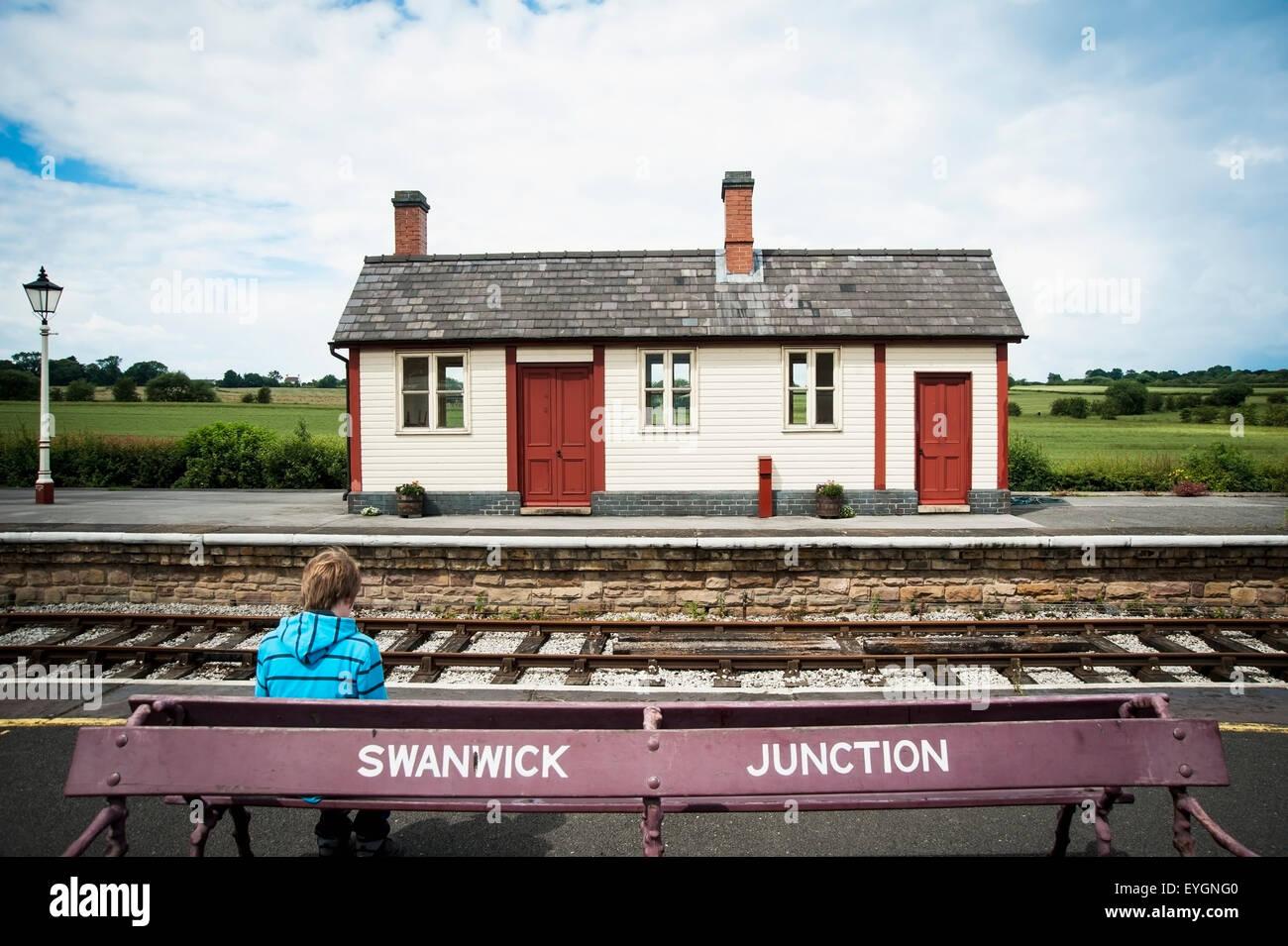 UK, England, Midland Railway; Derbyshire, Boy waiting at Swanwick Junction - Stock Image