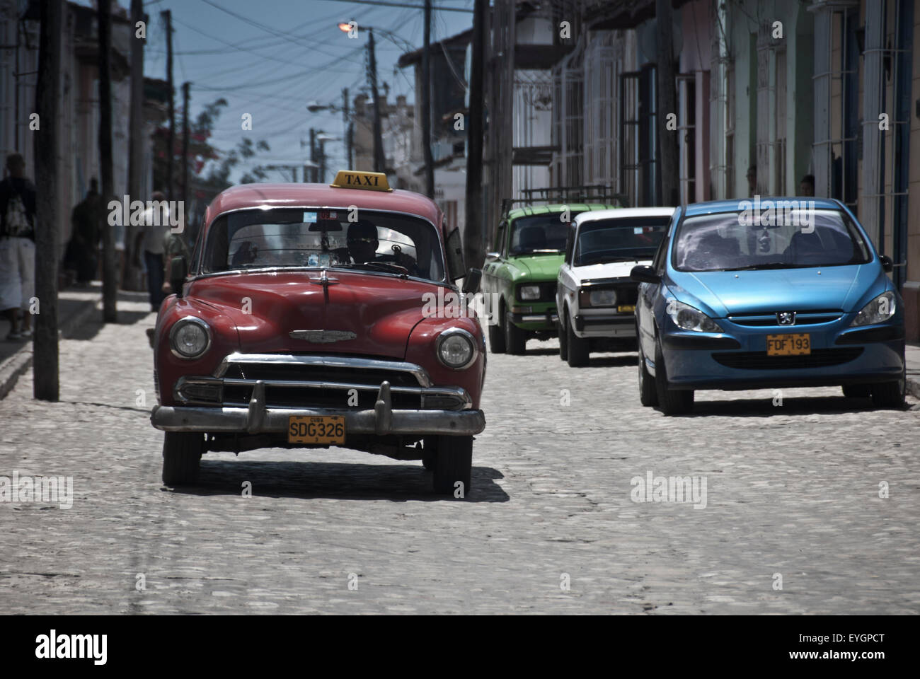 Vintage American car in Cuba with modern cars in contrast Stock ...