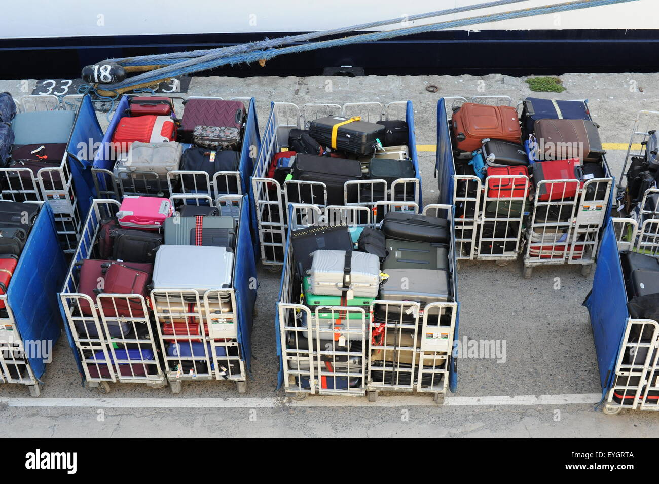 Colorfull suitcases in waggons to be boarded on a cruiseship passenger's luggage Kreuzfahrt Gepäck Koffer - Stock Image
