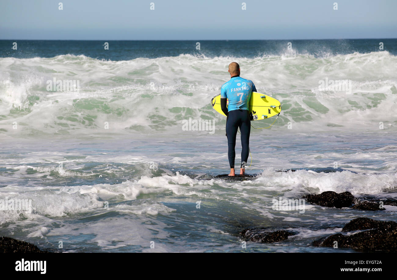 Australian professional surfer Mick Fanning entering the water at the 2015 J-Bay Open surfing event in Jeffreys - Stock Image