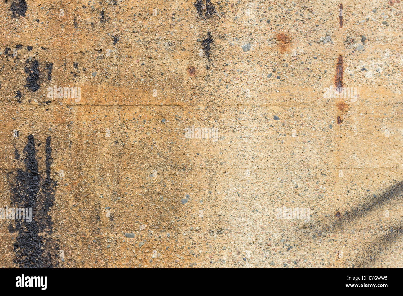 Close Up Of A Dirty Pale Brown Concrete Wall With Spray