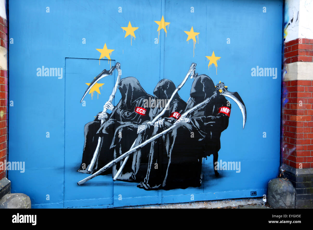 The ECB, IMF and EU each depicted as The Grim Reaper in a Satirical Graffiti painting on a garage door in Bristol, - Stock Image