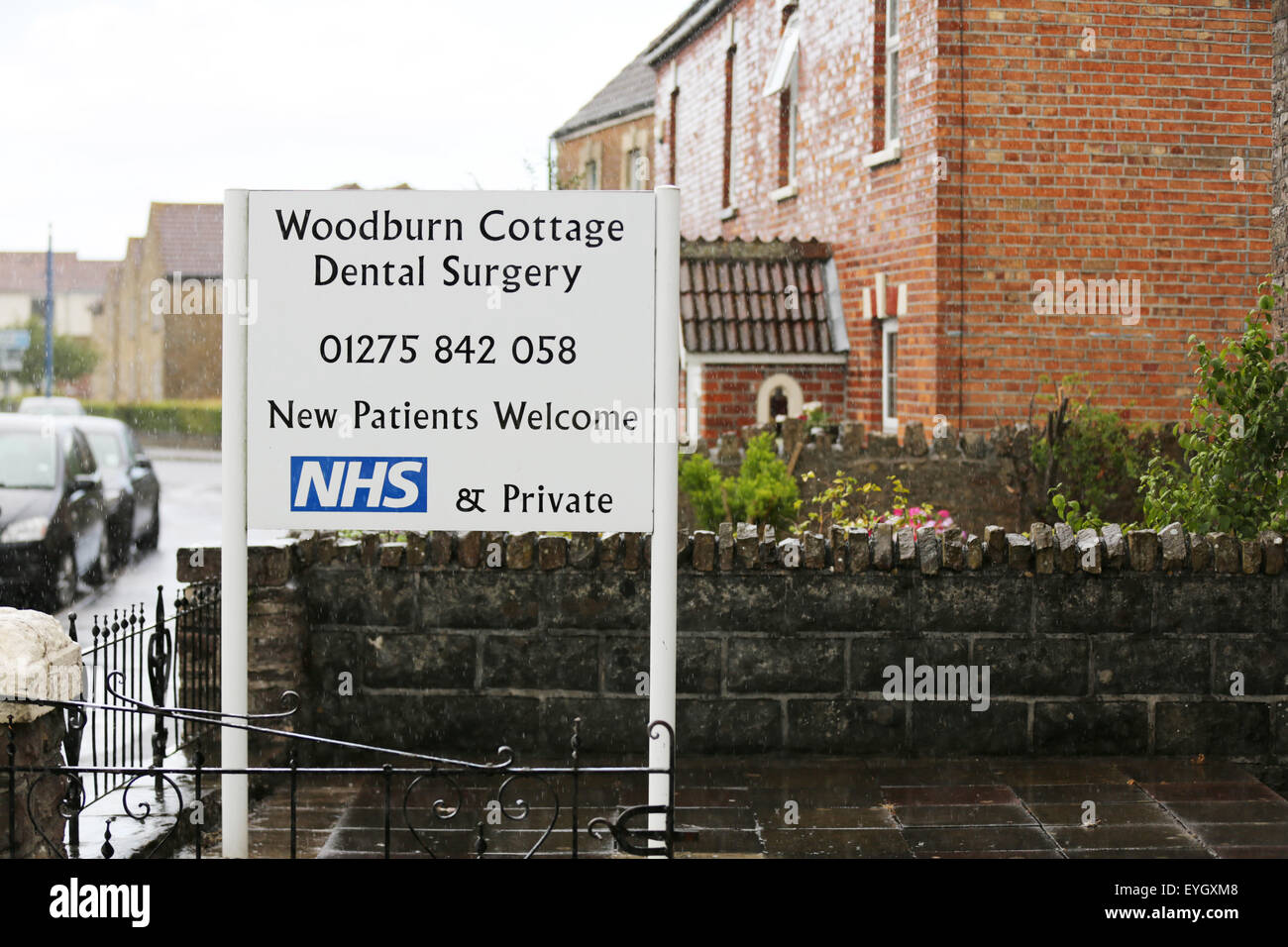 An English NHS/Private Dentist sign outside a Dentist Surgery on a town High Street. - Stock Image