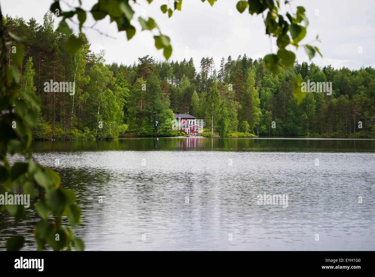 Finnish house on the shore of forest lake in the Vierumaki Sports Centre. - Stock Image