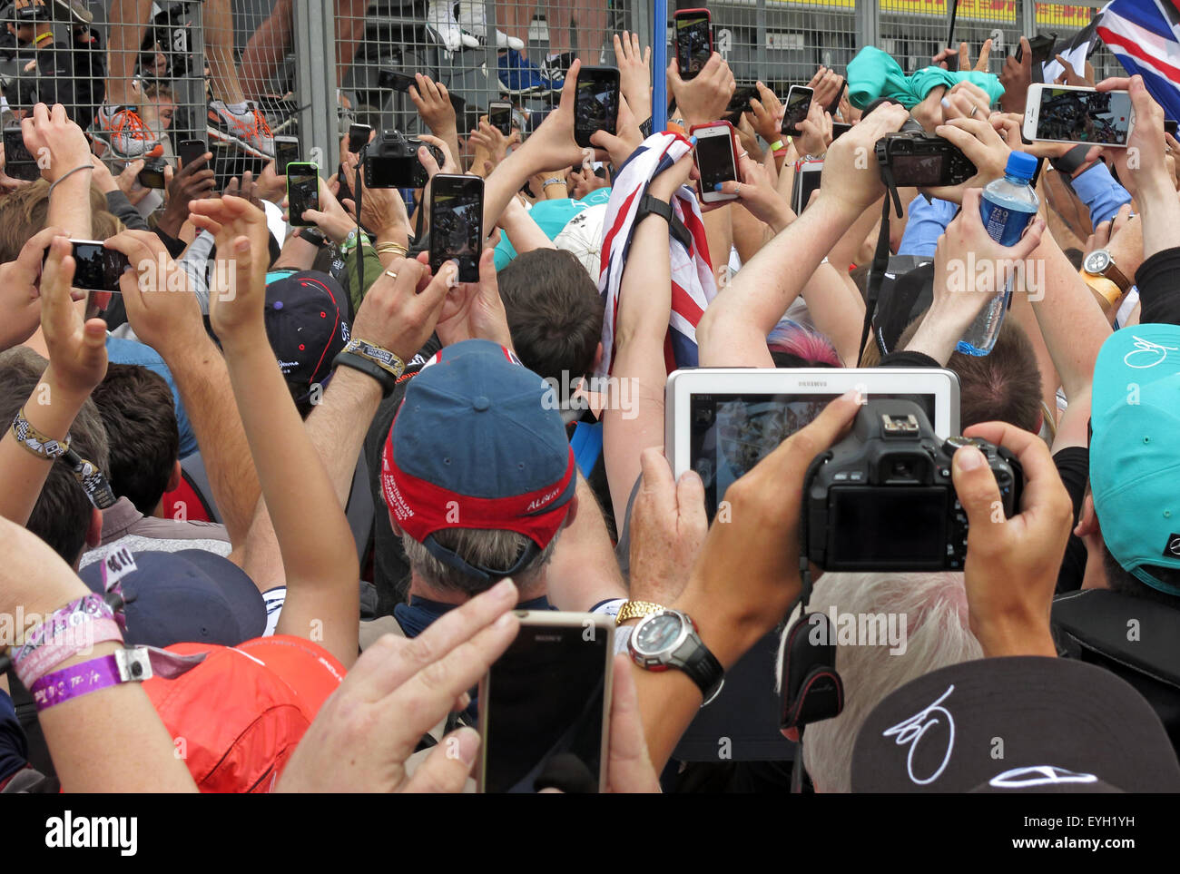 Crowd of people all with cameras,phones & tablets at an event Stock Photo