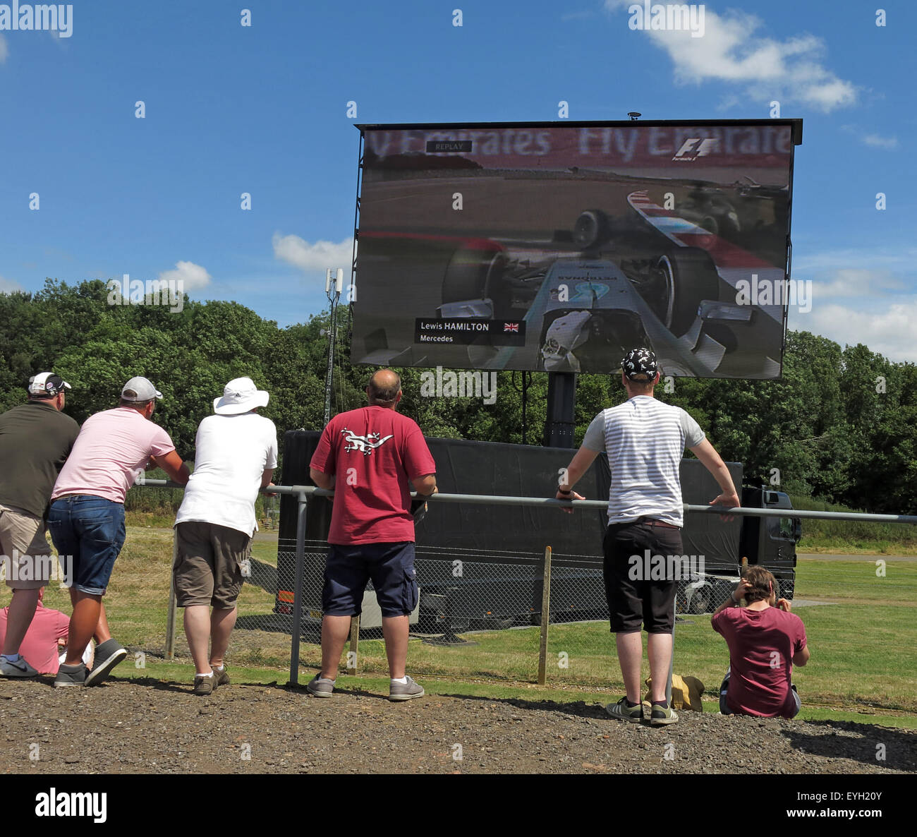 Silverstone F1 British Grand Prix GP England,fans watching Lewis Hamilton qualifying on a large screen - Stock Image