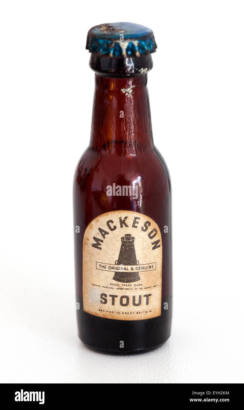 Miniature Vintage English Mackeson Stout Beer Bottle - Stock Image