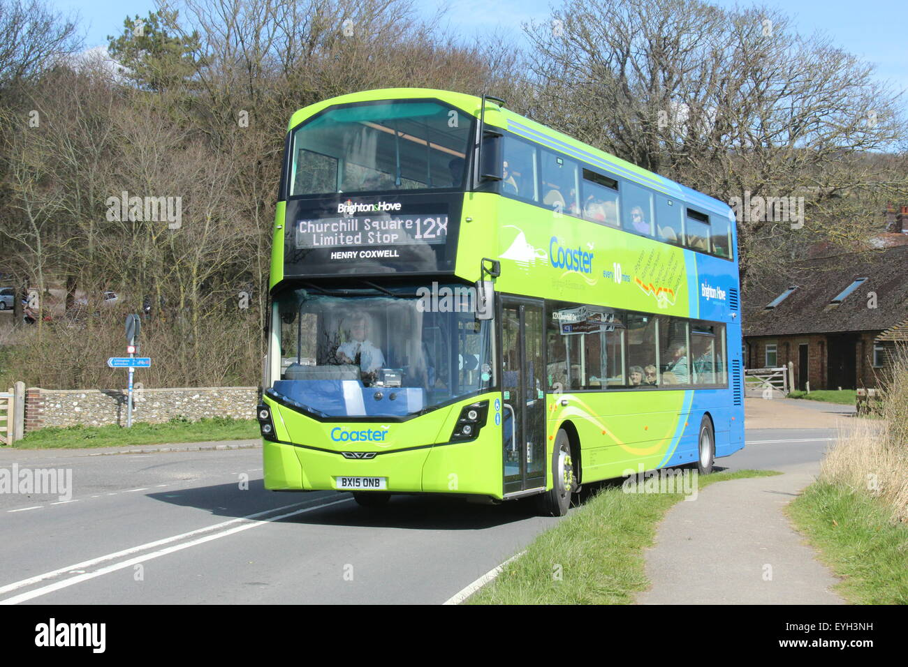 a green and blue brighton & hove wright streetdeck double deck bus