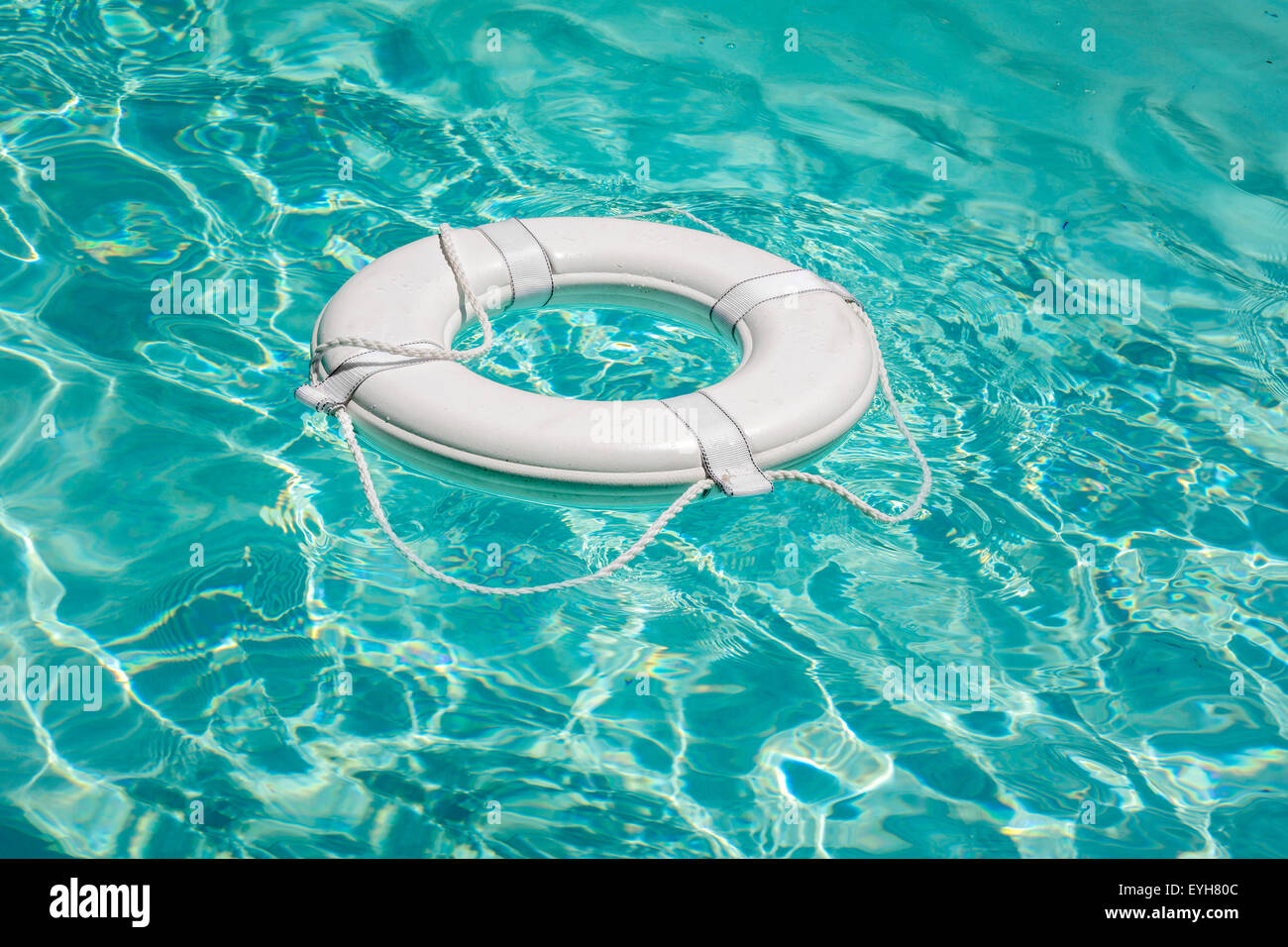 Life buoy in swimming pool life saver - Stock Image