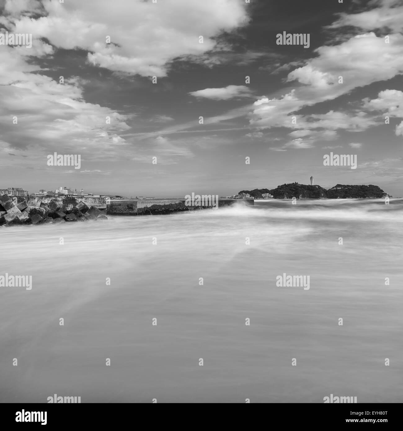 Waves crashing on the shore at Kugenuma-Kaigan beach, Kanagawa Prefecture, Japan - Stock Image
