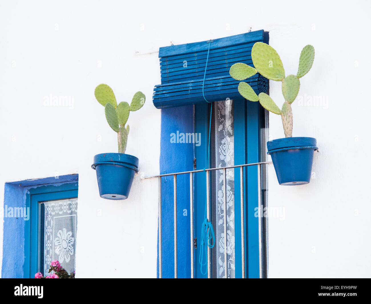 Pot plants on a house in Spain - Stock Image