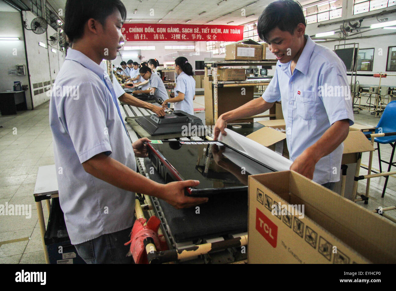 (150730) -- HO CHI MINH CITY, July 30, 2015 (Xinhua) -- File Photo taken on July 10, 2015 shows people work at the - Stock Image