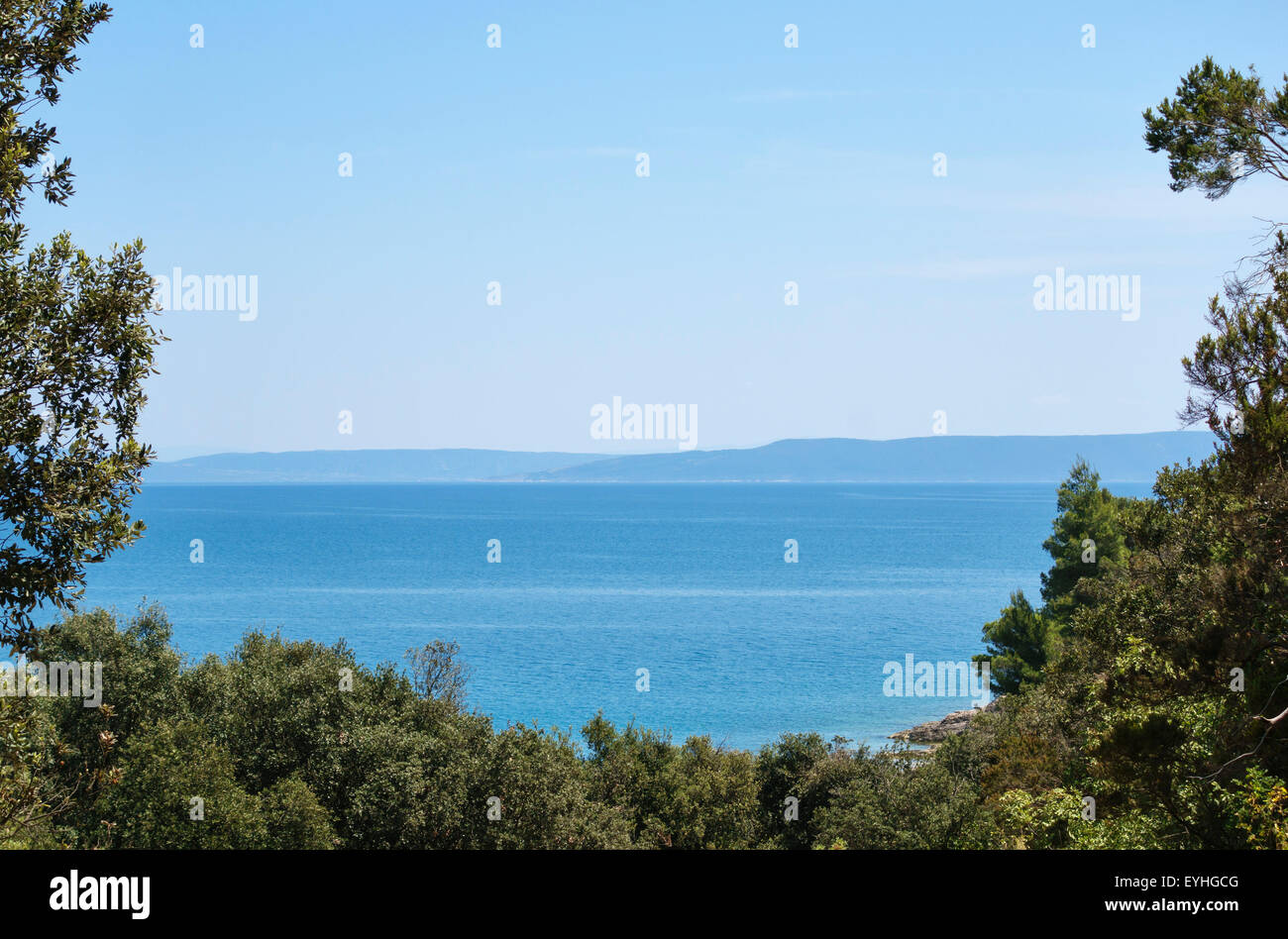 Istria, Croatia. A view from Duga Uvala across the Adriatic towards the distant island of Cres in the Kvarner Gulf - Stock Image