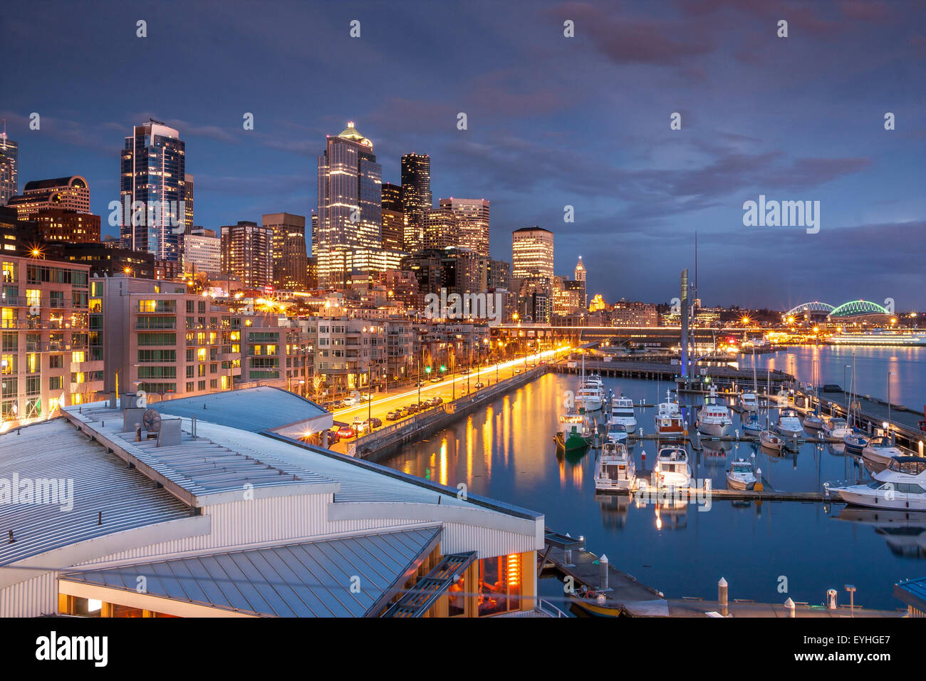 Seattle Waterfront At Dusk with the Marina in the foreground from The Bell Street Terminal, Seattle , WA , USA - Stock Image