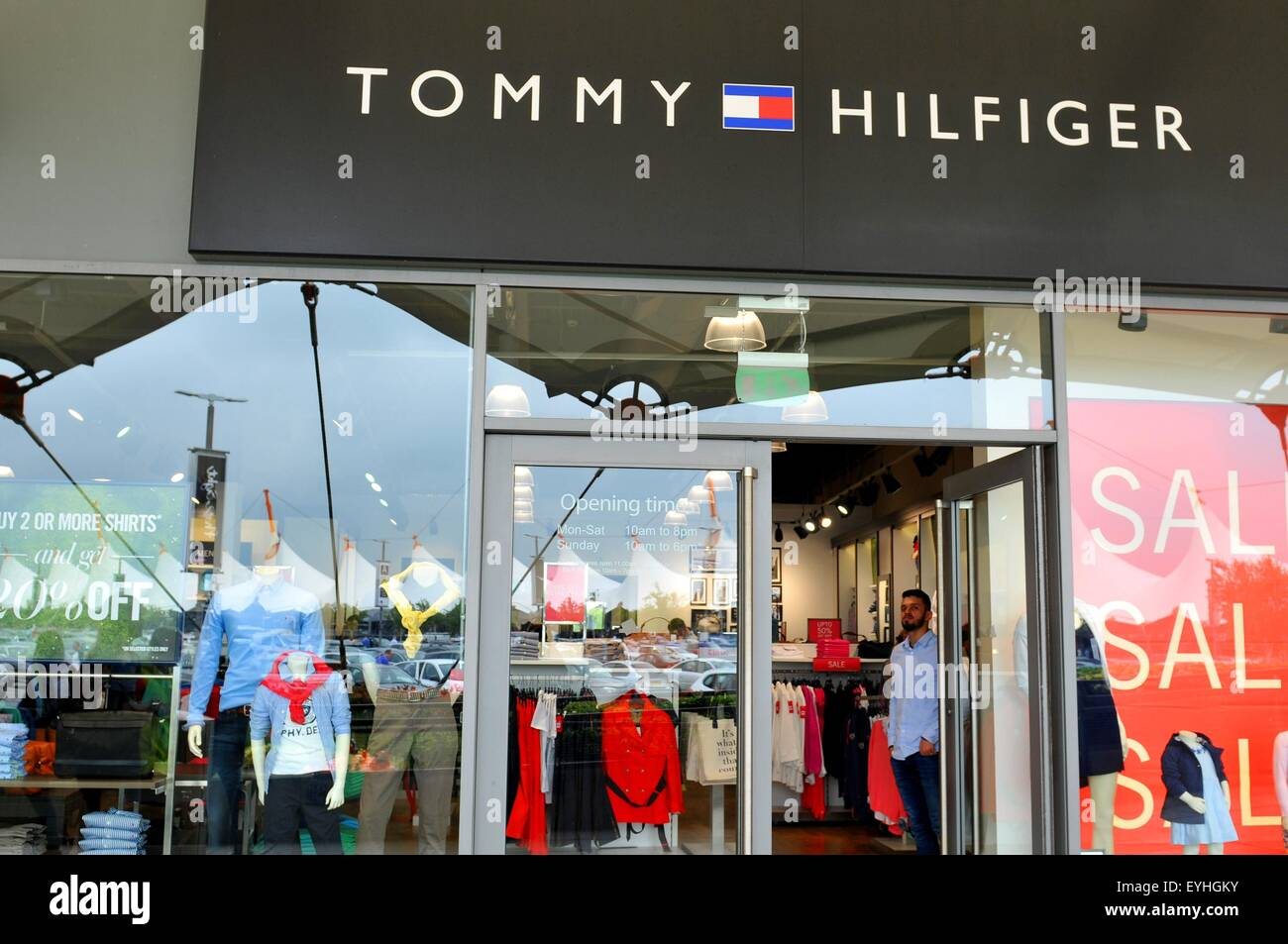 ee765cad London, UK - June 14, 2015: People pass by the Tommy Hilfiger shop. Tommy  Hilfiger is a famous worldwide American fashion
