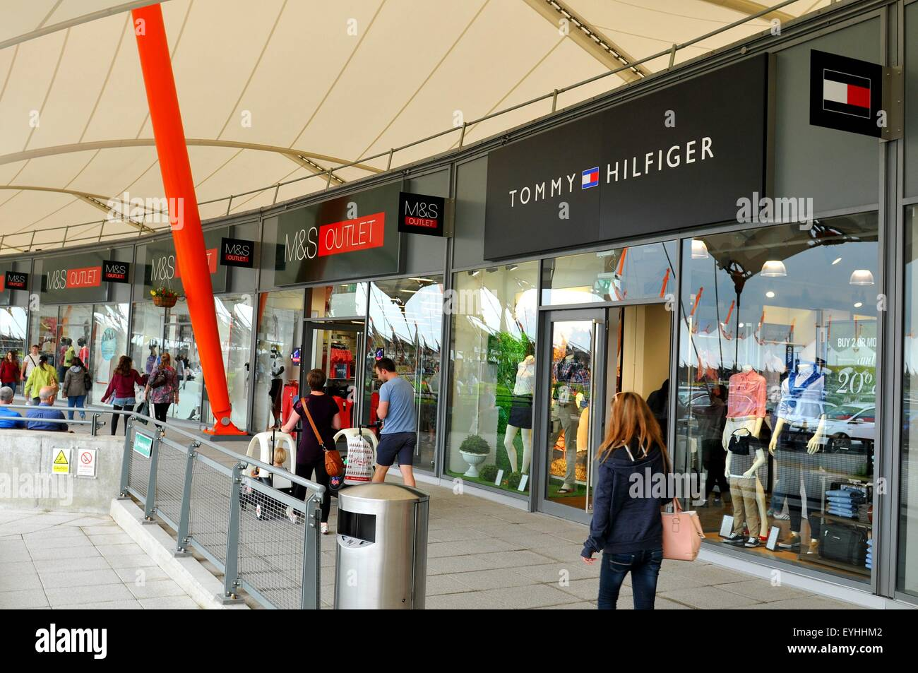 ff448395 London, UK - June 14, 2015: People pass by the Tommy Hilfiger shop. Tommy  Hilfiger is a famous worldwide American fashion