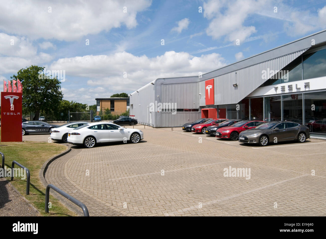 tesla electric car cars dealer dealers dealership dealerships non franchised model s models range Crawley uk showroom - Stock Image