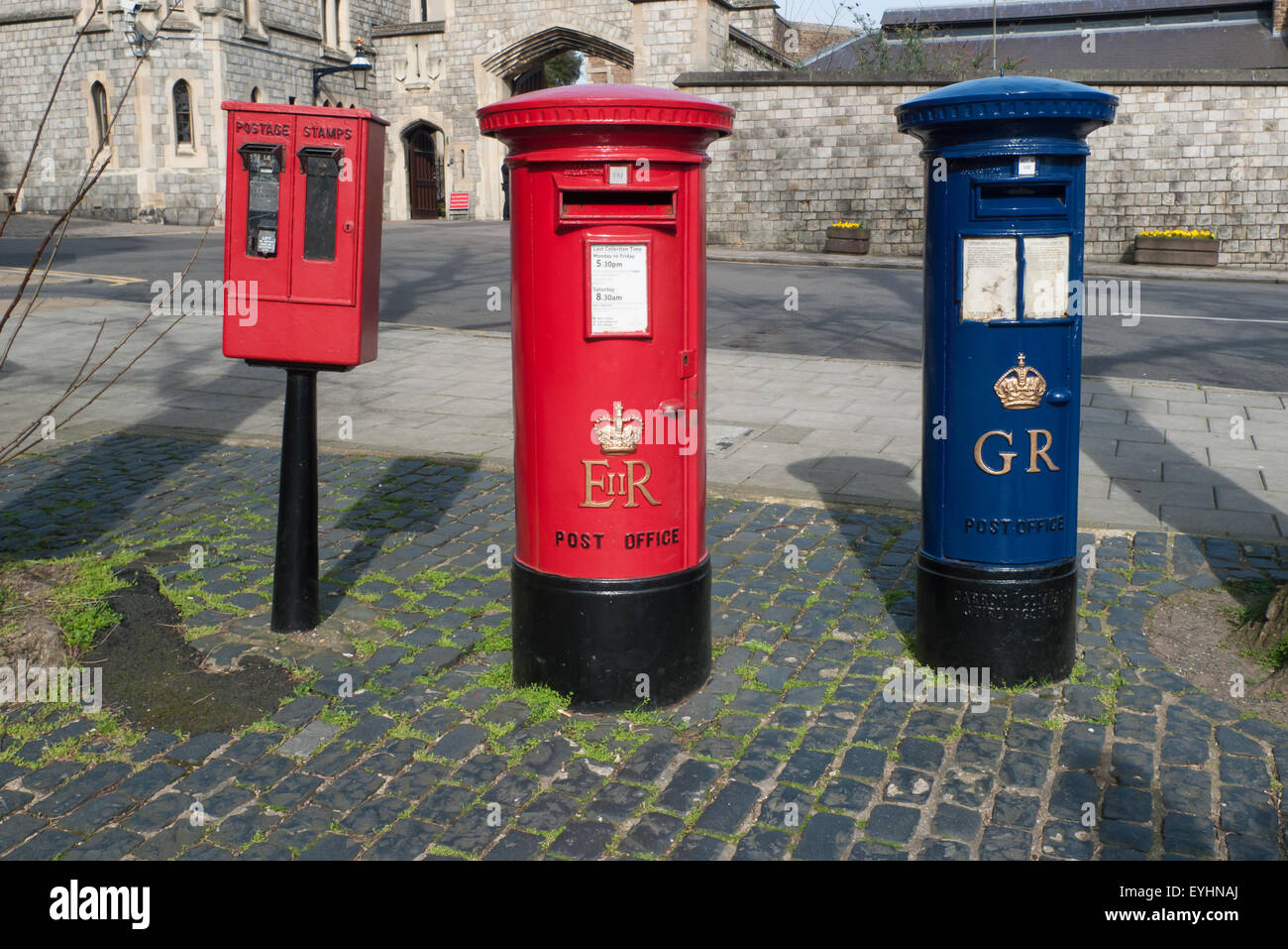 Windsor, England. Red postage stamp machine and post box marked EIIR, old blue airmail pillar box marked GR, Coronation Stock Photo