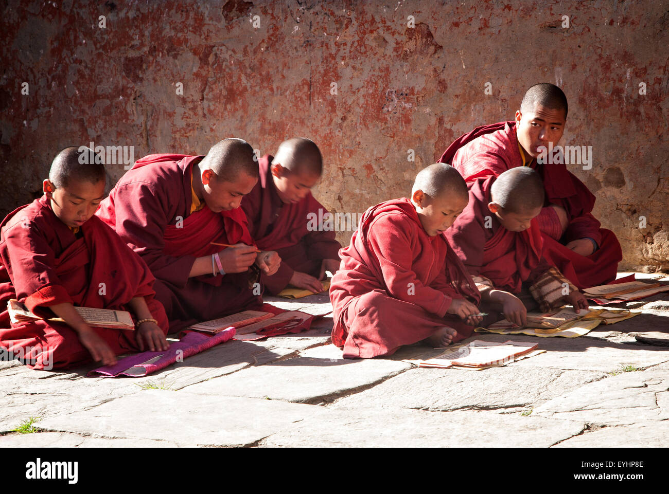 Young boys learning to be monks at Kenchosu Lhakhang (monastery) in Jakar, Bumthang District. Bhutan. - Stock Image