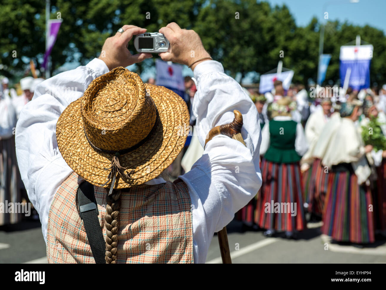 Man in latvian national costume take a photo - Stock Image