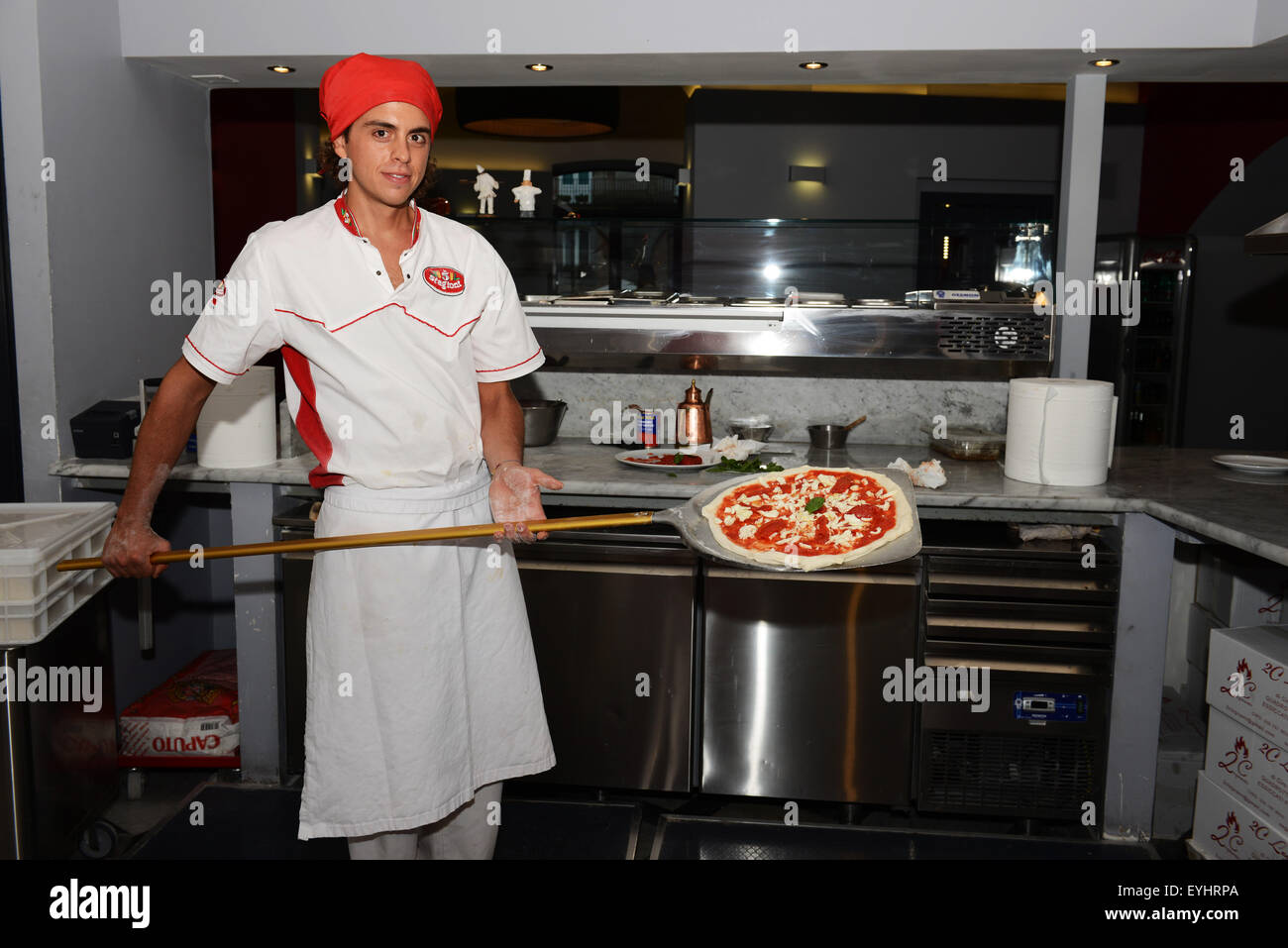 Alessandro Izzo, the pizza chef of pizzeria Palazzo Petrucci in the center of Naples. - Stock Image