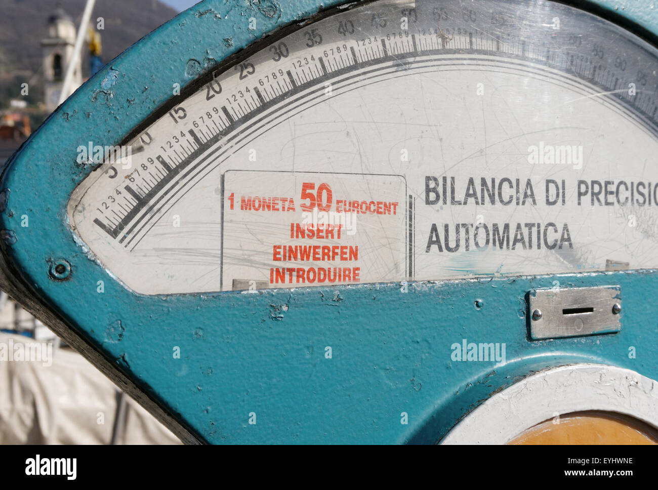 Old coin operated weigh scale in Italy - Stock Image
