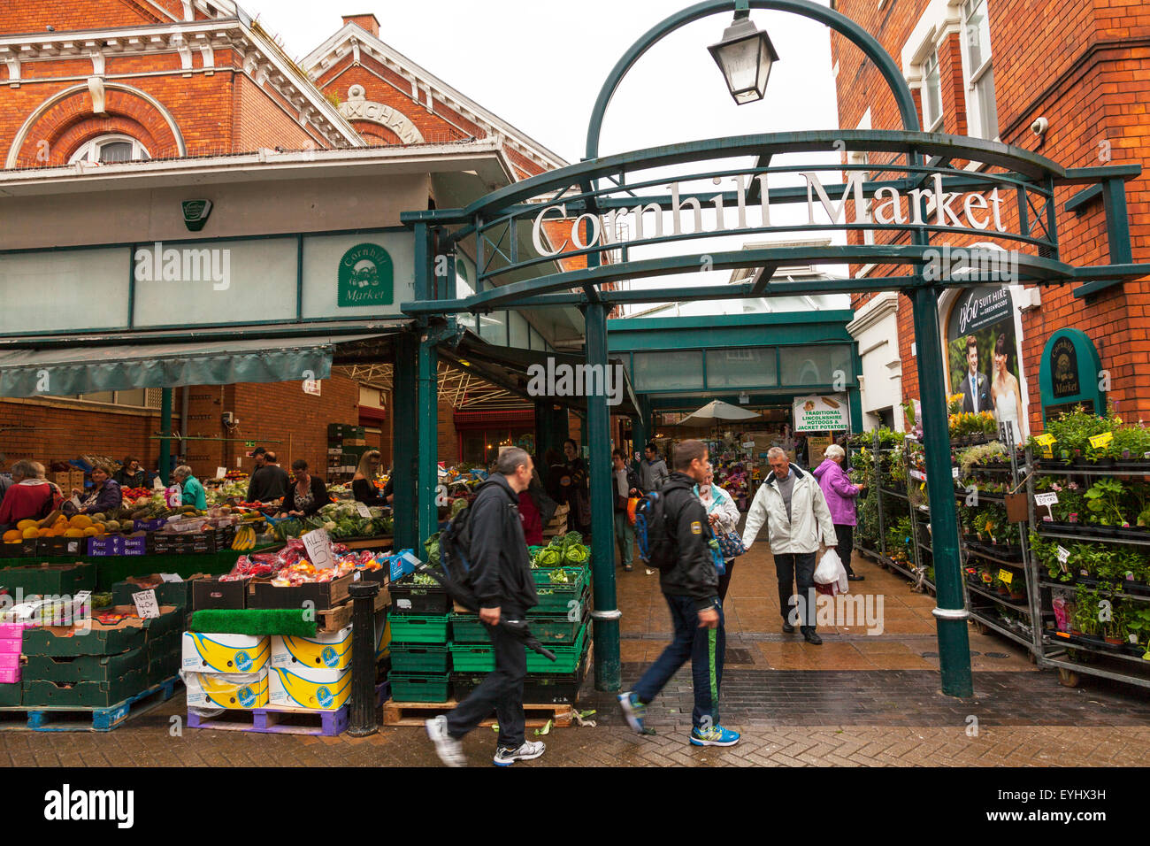 Cornhill market Lincoln City stalls traders selling goods from stall flowers fruit veg vegetables Lincolnshire UK - Stock Image
