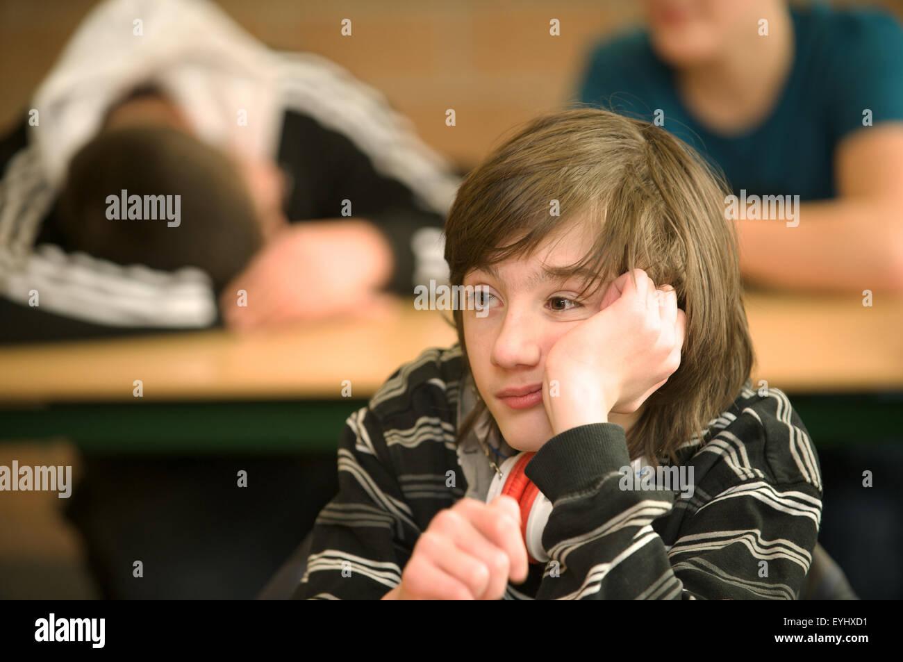 Board schoolboys in class - Stock Image